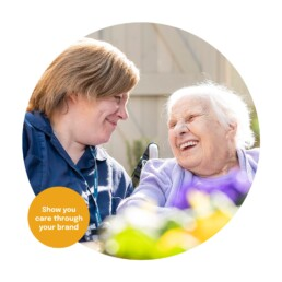A carer enjoying time with a care home resident. Branding for care homes.