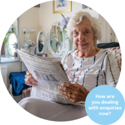 A resident enjoying a newspaper in their care home room. Marketing for care homes.